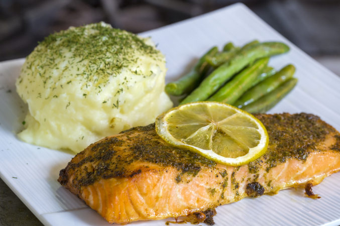 LUC banquet / wedding reception catering - grilled salmon covered with herbs and lemon slice, mashed potato medallion covered with fresh dill, and sauteed and or steamed asparagus.